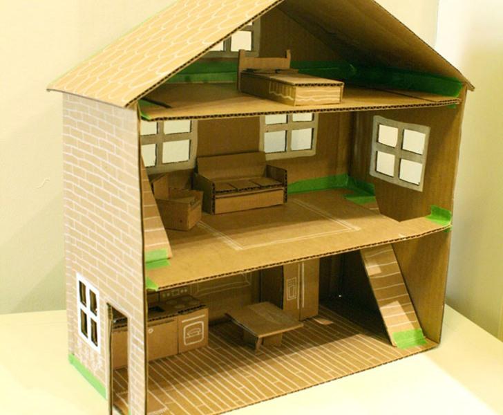 brinquedos recicláveis - casinha de papelão